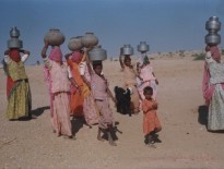 25. women & children carrying water from naadi.